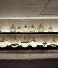 Lighting in behind on the tops of each shelf to create a shady mood. Genius! vineetkaur:  This distillery in Germany