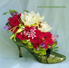 Fresh Flower Shoe Arrangement  A nice take on flower arranging.........