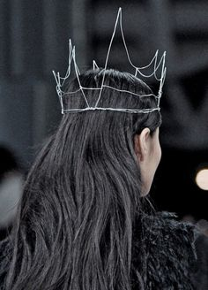 Make a crown as a prop out of old coat metal hangers!