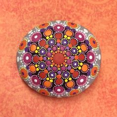 My mandala stones are hand painted and protected with two coats of matte vanish. They are not suitable for outdoor use however. The smooth surface