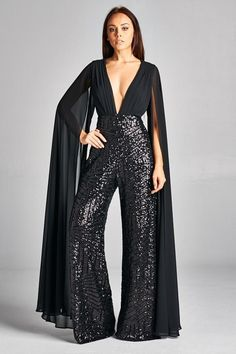 Very sexy and elegant womens jumpsuit with sequin detailed pants and solid black upper. Jumpsuit also has a sheer cape attachment and open back. Sizes correspond with standard U. measurements for letter size listed. Evening Dresses, Prom Dresses, Formal Dresses, Formal Wear, Mini Dresses, Ball Dresses, Short Dresses, Prom Jumpsuit, Black Sequin Jumpsuit