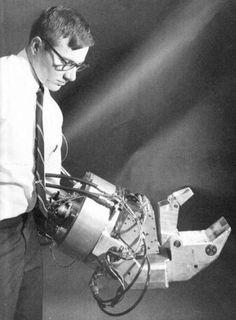 """Retro-Futuristic, Robot, Cyborg, Cyberpunk, Sci-Fi"" Looks like something from Hellboy."