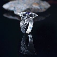 If your size is not in the options, please write to us and maybe well do it.  silver ring Phoenix with natural gemstone.  Material: Sterling silver (925), Sterling silver with Gold plated The choice of stones: Garnet (red), amethyst (purple), Topaz (blue), Chrysolite (light green), Citrine ( yellow)   This bird is generally thought to be a symbol of freedom. Many cultures believe that they are a symbol of eternal life; the link between heaven and earth.  Ancient Symbolism of the Magical…
