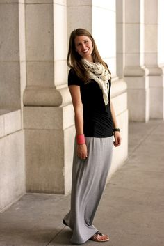 Gray maxi skirt, denim jacket, white tee, and silver t-strap ...