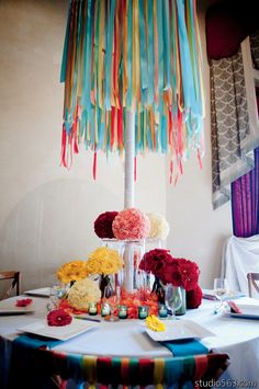 Love all the color!    Whimsical Ribbon Chandelier. Floral by Bouquets of Austin.
