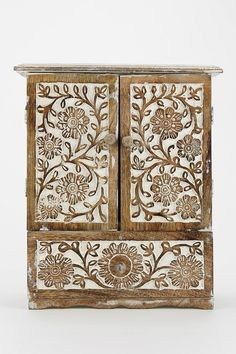 How adorable is this?! I'm almost tempted to spend the $50 on this! Urban Outfitters Carved Wood Jewelry Cabinet