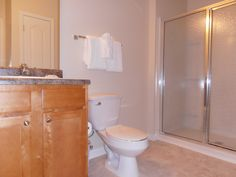 bathroom includes an oversized shower and linen closet