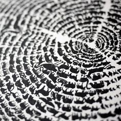 "From afar, the piece looks like a textured tree ring but upon viewing up close, the rings turn out to be hundreds of graphic animals walking in procession around the tree ring curves. The designers created the print ""to highlight the responsibility we have in letting animal species thrive in their natural environment."""