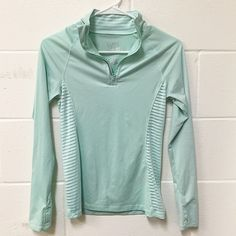 Quarter zip Aeropostale athletic jacket Light mint green, Good condition except for one tiny pink mark (picture 3), no sweat material, 86% polyester 14% spandex, super soft, sides are partially see though but not revealing Aeropostale Jackets & Coats