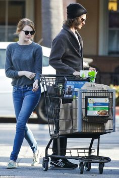 Together again: Emma Stone and Andrew Garfield were spotted grocery shopping together in M...