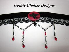 Black velvet and lace choker with red dragon cameo, black chains and red and black crystals. Absolutely gorgeous! R180 approx $18. https://hellopretty.co.za/gothic-choker-designs/red-dragon-choker