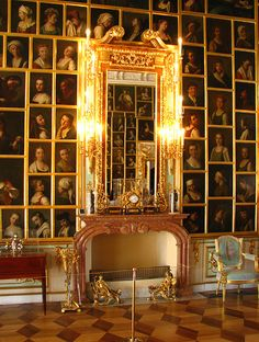 THE GREAT PICTURE HALL AT PETERHOF Palace of Peter the Great, Saint Petersburg, Russia. In 1764 using  Vallin de La Mothe's design, the pictures and the wall-papers of Peter's collection were replaced by Catherine II. The then fashionable portrait sketches made by Pietro Rotari (1707-62). The collection of those portraits was bought by Catherine II right after the artist's death. The Picture Hall has 368 pictures set in a framework system imitating a carpet.
