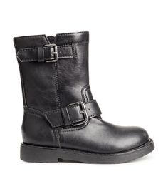 Biker boots in imitation leather. Adjustable tabs at front and at top of leg, zip at side, and rubber soles.