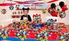 Set up big-impact decorations like a custom Mickey Mouse birthday banner, balloon bouquet and streamers in one area like your dining room for maximum WOW from your party budget.