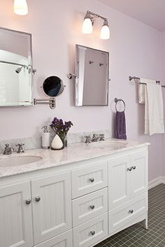 Bathroom Sink Jammed white and tan bathroom features a white dual sink vanity topped