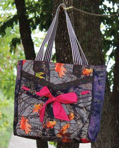 "Hotleaf Camo Pink Bow Tote | ""gifts for cowgirls"" ""gifts for huntresses"" ""gifts for women"" christian cross leopard animal print #pinkcamo hot pink leaf striped magenta white tail deer elk shotgun shooting target gun ""gifts for hunting enthusiasts"" Casual Outfits for women #countrygirl #CountryFashion #countryoutfits drysdales.com #Fall2015 boutique shopping tote carryall large bag ""pretty in pink"""