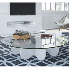 The Waverly Coffee Table by Manhattan Comfort stuns with a circular glass top over an elaborate and distinctly modern �cloud� shaped base. Quality and attentive design make the Waverly a perfect stand-out choice,