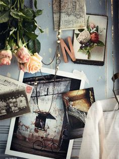 love the polaroids, change the flowers to yellow buttercups or bright purple flowers, and change the letter from N to A, perhaps hang a leather bag instead of a blouse?