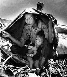 A Vietnamese woman uses a blanket to shelter herself and her child from the hot sun aboard a refugee boat in Nov. They are among 50 refugees aboard a fishing boat in the Gulf of Siam looking for freedom in Thailand. Fly Fishing Line, Best Fishing, Fishing Tips, Fishing Boats, Vietnamese Boat People, Refugee Boat, Miss Saigon, Fishing For Beginners, Fishing Photography