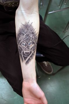 Amazing wolf tattoo design, love the blue eyes