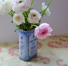 Flowers in an olive oil tin - cute idea
