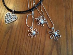 Silver flowers and heart, made by Anne
