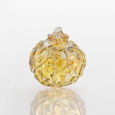 Filigree by Lucky Ducks Glass: Art Glass Ornament available at www.artfulhome.com Intricate tendrils unfurl across a graceful sphere of amber glass with reflective pink fuming.