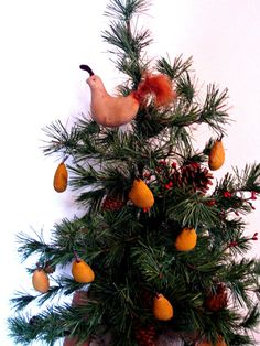 A PARTRIDGE AND PEARS ON A CHRISTMAS TREE.