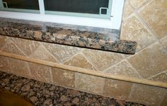 Baltic Brown Granite window sill with travertine tile backsplash Travertine Tile Backsplash, Granite Slab, Granite Kitchen, Backsplash Ideas, Tiles, Kitchen Sinks, Granite Countertops, Kitchen Backsplash, Marble Window Sill