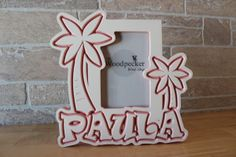 www.woodpeckerwoodshop.etsy.com Personalize this tropical themed palm tree picture frame for the favorite kid in your life!  Search on Etsy for WoodpeckerWoodShop for 100+ personalized children's frames - choose your name, colors and theme!