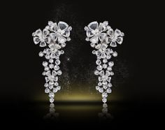 White   This creation, inspired by nature, includes an irresistible combination of briolettes, pears and round rose-cut diamonds. Laced with floral motifs of nearly 30 carats of diamonds finely set in 18k white gold, these earrings are uniquely designed with a detachable cascade and can be worn as long or clip earrings.