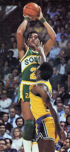Dennis Johnson shoots over Magic Johnson.