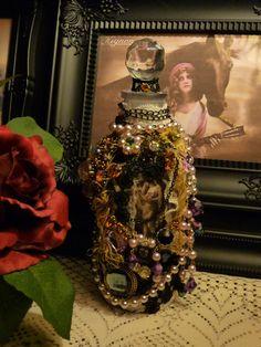 altered glass bottle GYPSY lace and jewel  mixed media embellished bottle. $56.00, via Etsy.