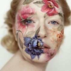I love the detail in this face paint, and the delicate nature of both the flowers and the overall composition.