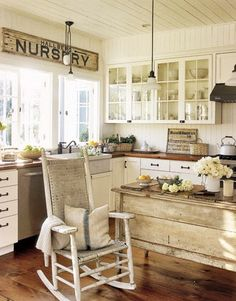 Creamy whites, wood counters, glass doors, rustic island