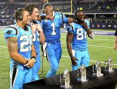 Carolina Panthers' Kurt Coleman (20), Luke Kuechly (59), Cam Newton (1), and Jerricho Cotchery (82) joke around while being interviewed after defeating the Dallas Cowboys 33-14 at AT&T Stadium on Thursday, November 26, 2015. The Panthers improved to 11-0.