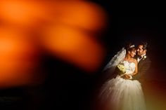 Bride and groom night portraits at the Beach Palace Hotel in Cancun, Mexico by Juan Euan Photography. Destination Wedding Photography. Contemporary wedding photographer