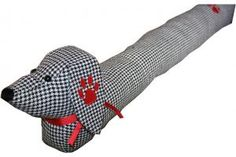 Daschund Draft Excluder! Look at this little guy, protecting your home from chills.