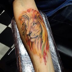 Watercolor lion tattoo by Katya Slonenko https://www.instagram.com/slonenkotattoo/