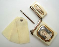 """Carnet de Bal, France, circa 1780 with a miniature of a young woman, a pink ribbon in her hair, and """"Here is my well,"""" inscribed on the reverse"""