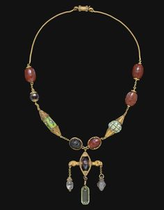 A NECKLACE OF ETRUSCAN SCARABS - CIRCA 5TH CENTURY B.C.