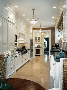 galley kitchen - cabinets of different depths work together with molding