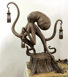 This would make for an awesome bedside table lamp if you could get lights in each lamp. #octopus