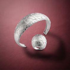 Conjunto de pulsera y anillo en plata de ley