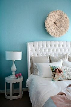 turquoise bedroom with white and accents of pink