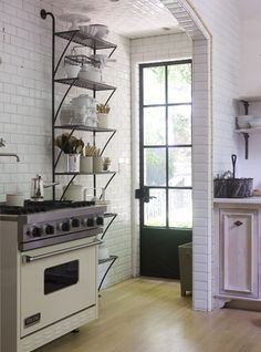 Kitchen renovated by Mike Hammersmith, Inc. in Atlanta - love the subway tile and the shelving