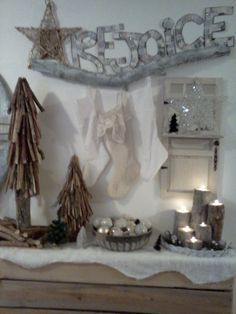 Rustic white neutral Christmas, stump  candles holders, stick branch trees, stockings, and stars