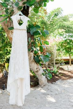 streamlined lace gown for a beach wedding / photo by ailynlatorrephotography.com