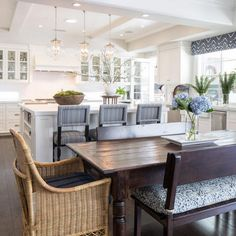 Kitchen and Dining Room. Dining room opens to kitchen. Open layout kitchen and dining room. Kelly Nutt Design.