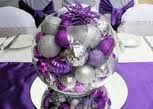 purple and silver baubles in a glass bowl. love the mirror underneath.